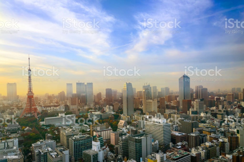 Cityscape of Tokyo, city aerial skyscraper view of office building and downtown of tokyo with sunset / sun rise background. Japan, Asia, Tokyo is metropolis and center of new world's modern business stock photo