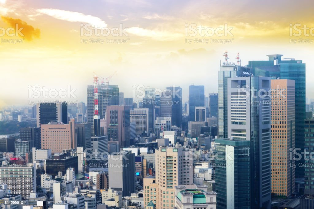 Cityscape of Tokyo city, japan. Aerial skyscraper view of office building and downtown of tokyo with sunset/ sun rise background. Tokyo is metropolis and center of new world's modern busniess stock photo
