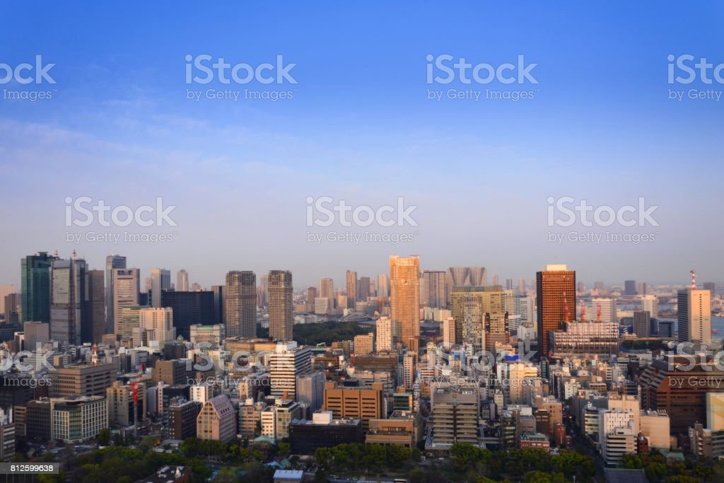 Cityscape of Tokyo city, view of aerial skyscraper, office building and downtown and modern architecture of tokyo with blue sky background. Japan, Asia stock photo