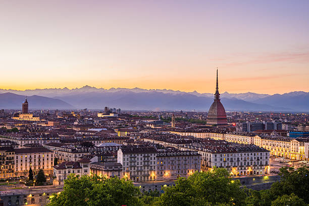 Cityscape of Torino (Turin, Italy) at dusk with colorful sky stock photo