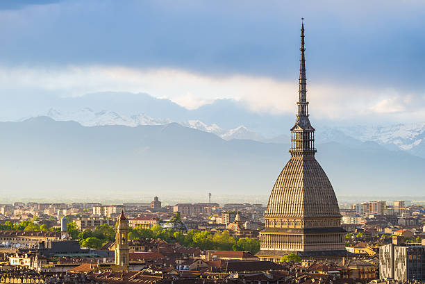 Cityscape of Torino (Turin, Italy) at sunset with storm clouds stock photo