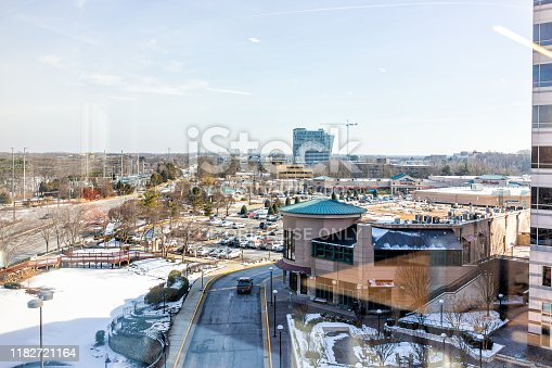 Reston, USA - February 2, 2019: Cityscape of town center office building on Sunset Hills street road in northern Virginia view from window