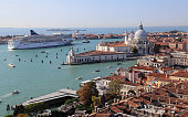 Cityscape of Venice, Italy, from the San Marco clock tower, looking toward the Punta della Dogana and the Santa Maria della Salute church in Venice, Italy on October 3, 2018
