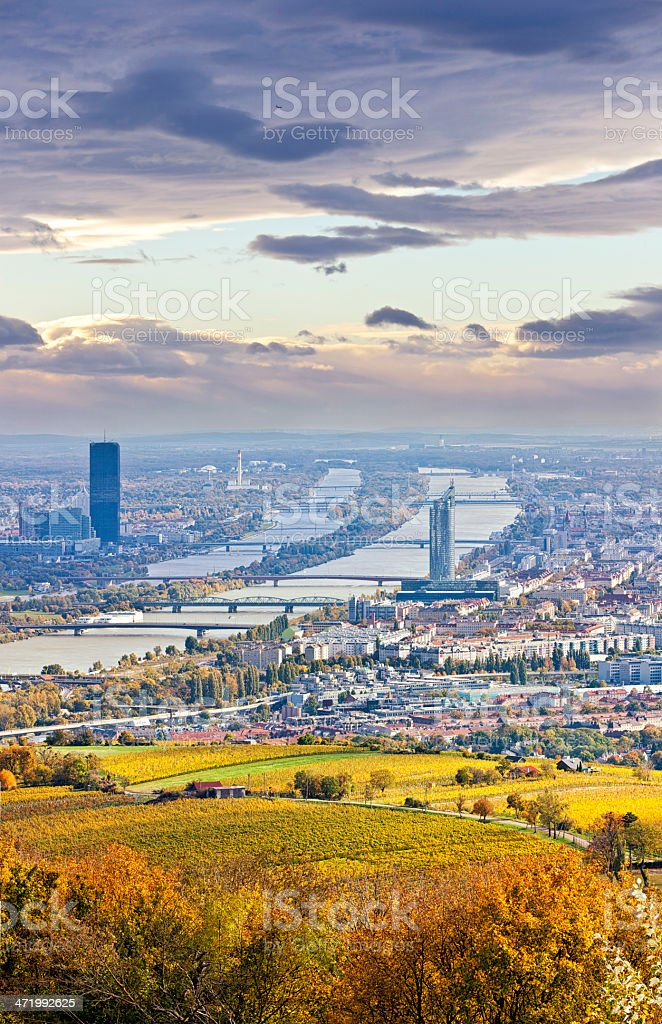 Cityscape of Vienna and Danube in the autumn at dusk stock photo