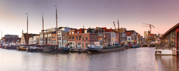 Cityscape, panorama, banner - view of city channel with ships, the city of Leiden Cityscape, panorama, banner - view of city channel with ships, the city of Leiden, Netherlands