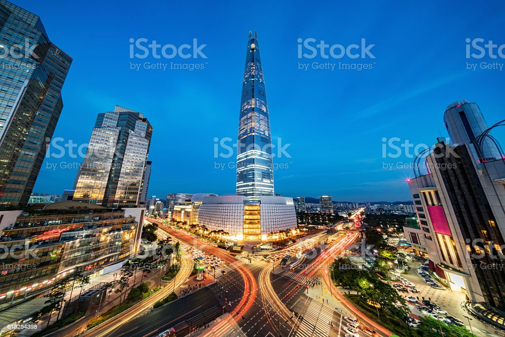 Cityscape Songpagu Skyscrapers Lotte World Tower at Night Seoul Cityscape of Songpagu district in Seoul at night. Motion blurred traffic lights, illuminated skyscrapers and Lotte world tower. Seoul, South Korea, Asia. Aerial view with 10 mm ultra wide angle 42 MP Sony A7RII. Architecture Stock Photo