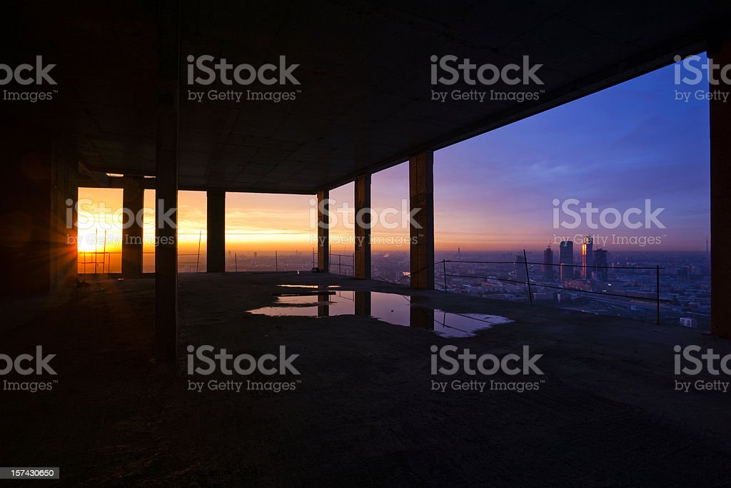 Cityscape view from construction site at sunset royalty-free stock photo
