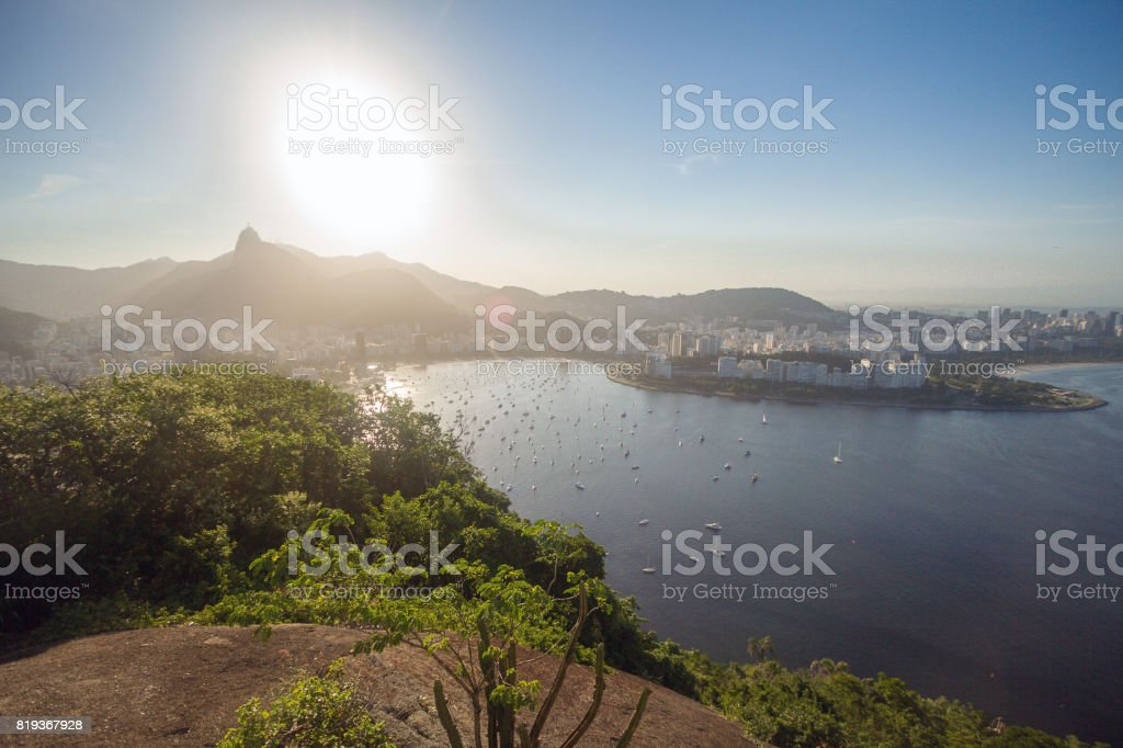 Cityscape view from the Sugarloaf mountain on the Guanabara bay, Botafogo beach and district, Corcovado mountain with Christ the Redemeer. Rio de Janeiro, Brazil. stock photo