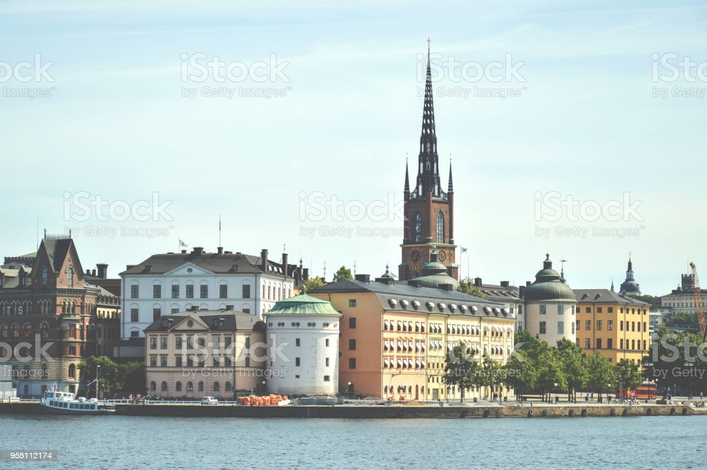 Cityscape view of Stockholm's old town in famous Gamla Stan area densely situated by archaic buildings influenced by North German architecture stock photo