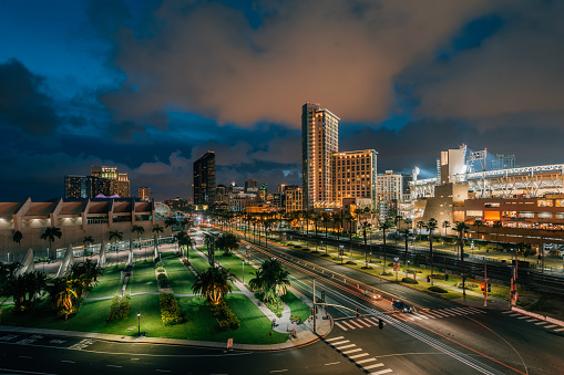 Cityscape view of the downtown San Diego skyline and Harbor Drive at night, in San Diego, California