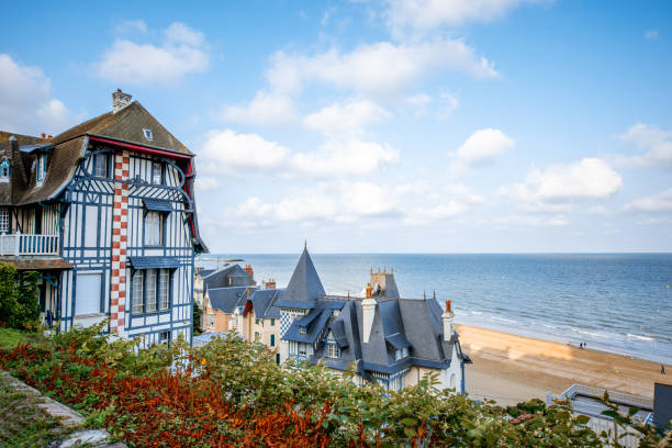 Cityscape view of Trouville in France Top view of Trouville city with luxury houses and beautiful beach on the background during the morning light in France normandy stock pictures, royalty-free photos & images