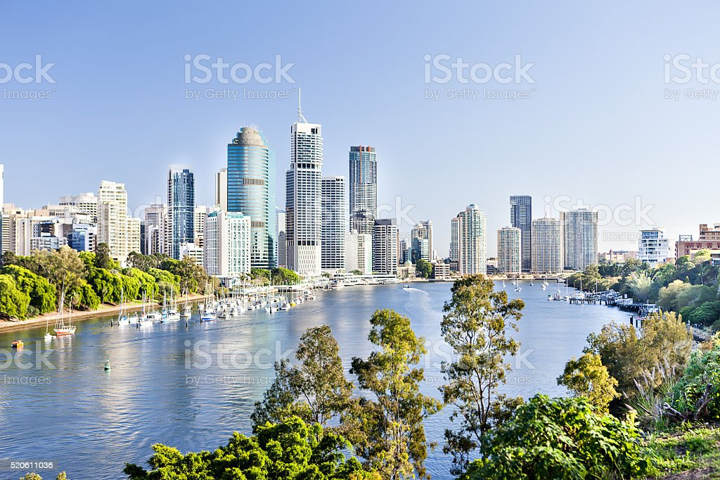 Cityscape with a river a lot of tall buildings stock photo