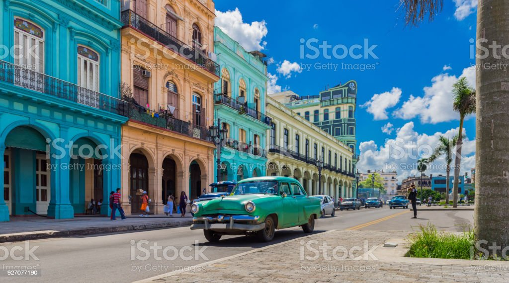 Cityscape with american green vintage car on the main street in Havana City Cuba - Serie Cuba Reportage stock photo