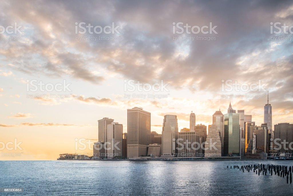 Cityscape with beautiful skyline at sunset, skyscraper in Manhattan, New York City stock photo