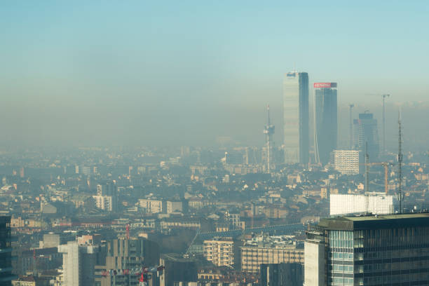 Cityscape with smog Milan, Italy - January 6, 2019: Milan landscape with smog, aerial view of the city with polluted air. smog stock pictures, royalty-free photos & images