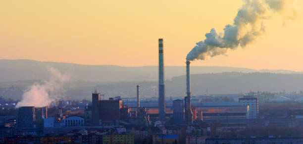 Cityscape with smoking stack from lignite combined heat and power plant plant  in Pilsen, Czech Republic. stock photo