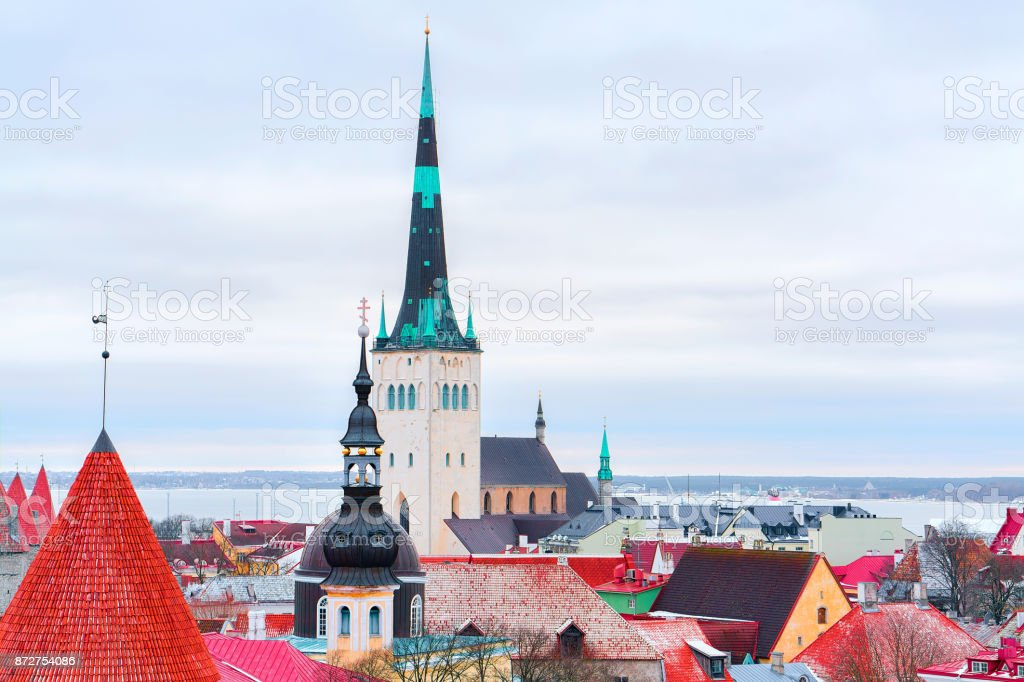 Cityscape with St Olaf Church and defensive walls in Tallinn stock photo