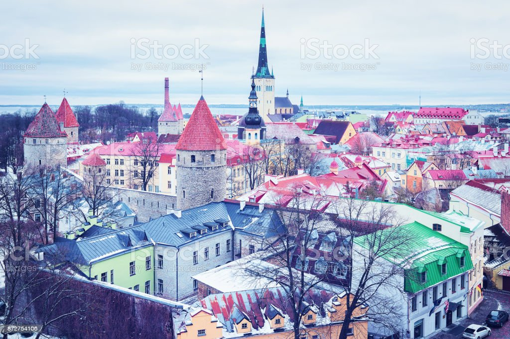 Cityscape with St Olaf Church and defensive walls of Tallinn stock photo