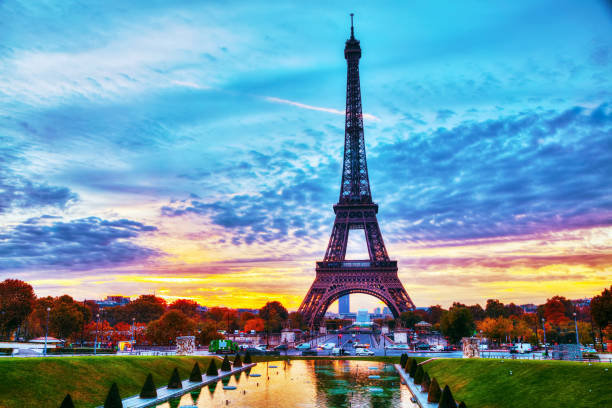 cityscape with the eiffel tower in paris, france - eiffel tower stock photos and pictures