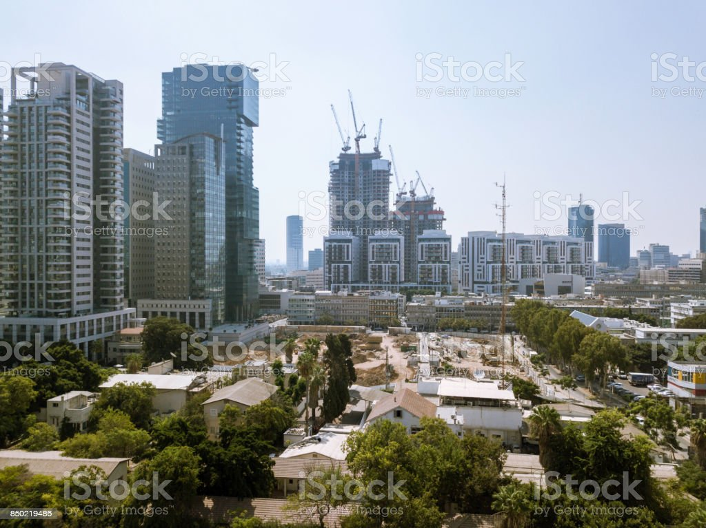 TEL AVIV, ISRAEL Cityscape with towers of Azrieli Center and Sarona area in Azrieli center is the main landmark of Tel Aviv. Old and New Architecture in Tel Aviv - O stock photo