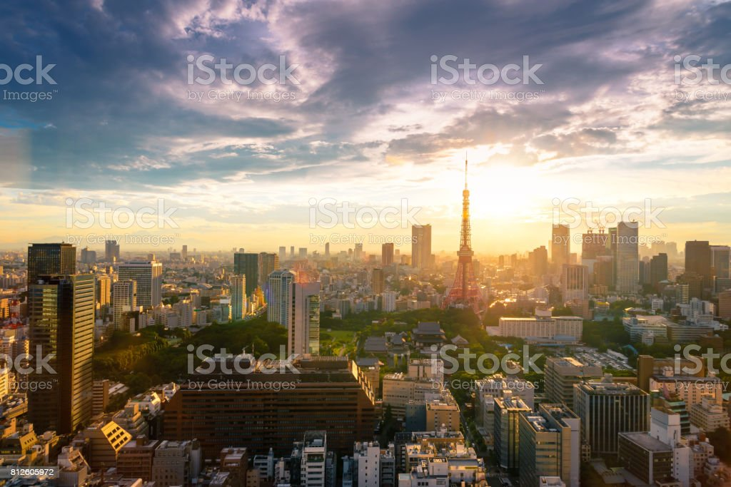 Cityscapes of Tokyo, city aerial skyscraper view of office building and downtown of tokyo with sunset / sun rise background. Japan, Asia, Tokyo is metropolis and center of new world's modern business stock photo