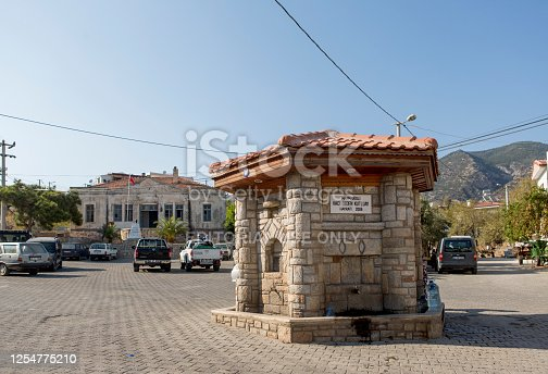 istock cityview and historical fountain of datca summer town of mugla turkey 1254775210