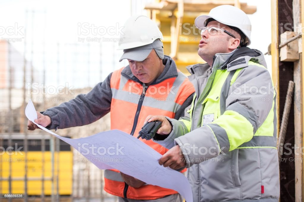 Civil engineer And Foreman at construction site are inspecting...