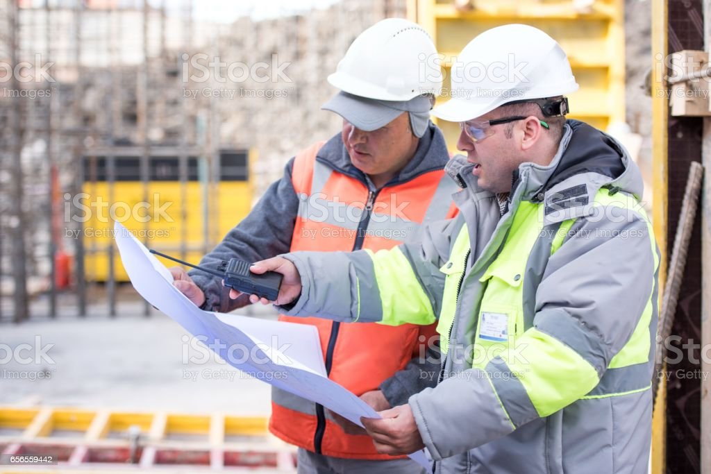 Civil Engineer And Foreman At Construction Site stock photo