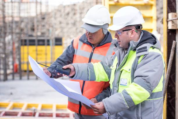 civil engineer and foreman at construction site - civil engineer stock photos and pictures