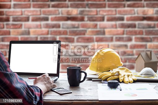 civil engineer helmet and laptop