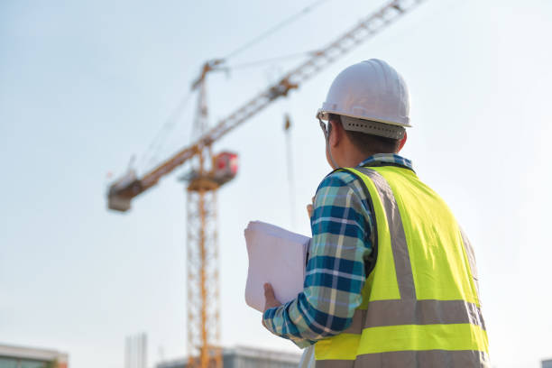 Civil engineer inspects work using radio communication with the management team in the construction area. stock photo