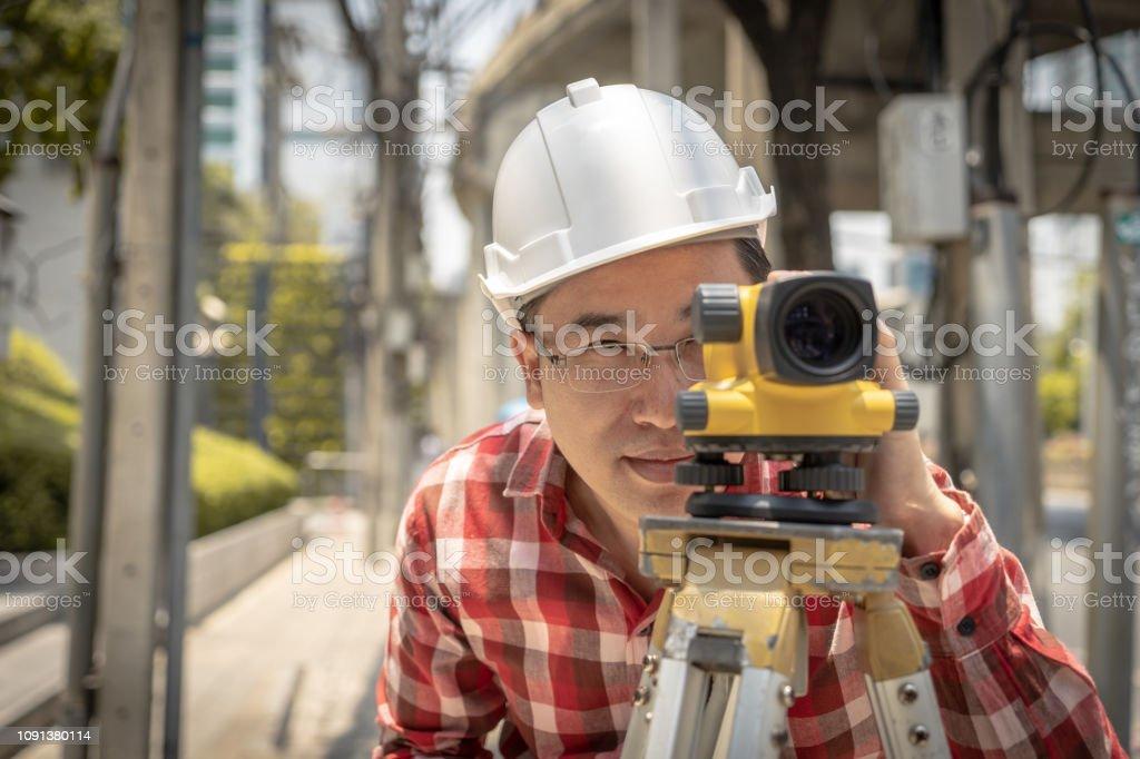 Civil engineer land survey with tacheometer or theodolite equipment....