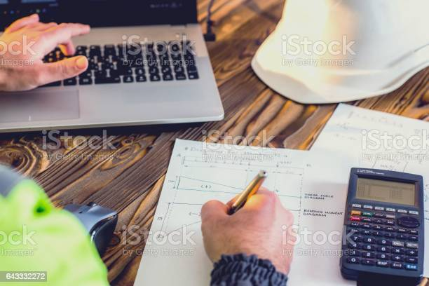 Civil Engineer Making Structural Analysis Calculations Stock Photo - Download Image Now