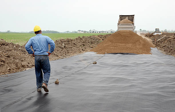 civil engineer on a road construction site with geo-textile - civil engineer stock photos and pictures