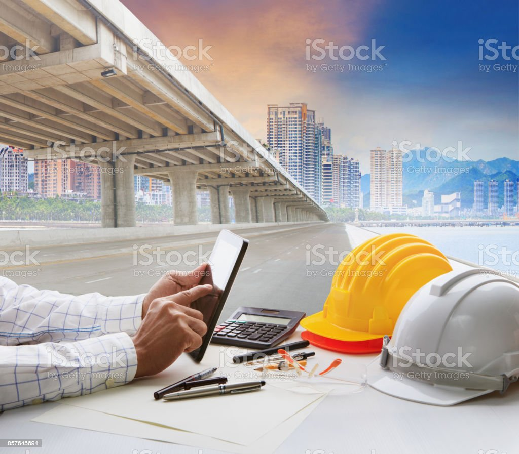 civil engineer working table and urban building with infra structure development stock photo