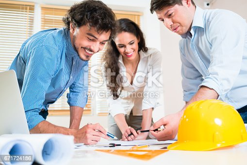 istock Civil engineers and architects talking about ground plot 671724186