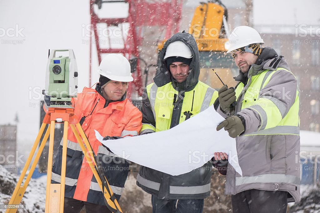 Civil Engineers At Construction Site In Winter – Foto
