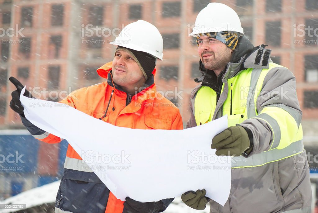 Civil Engineers At Construction Site In Winter Season stock photo