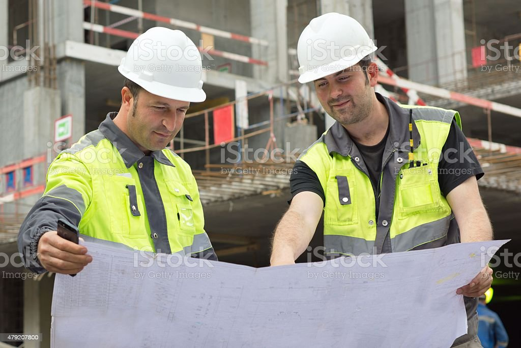 Civil Engineers At Construction Site stock photo