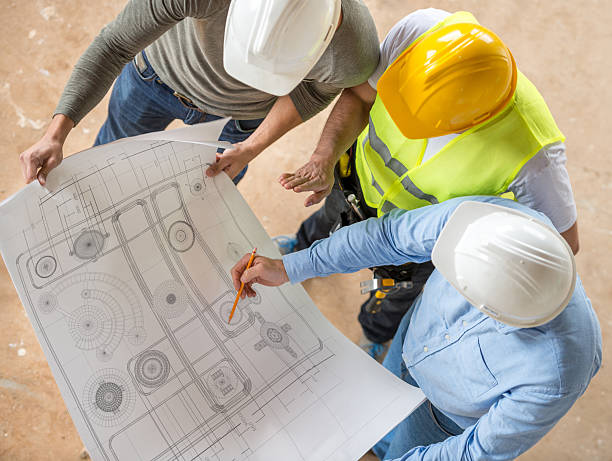 civil engineers looking at blueprints - civil engineer stock photos and pictures