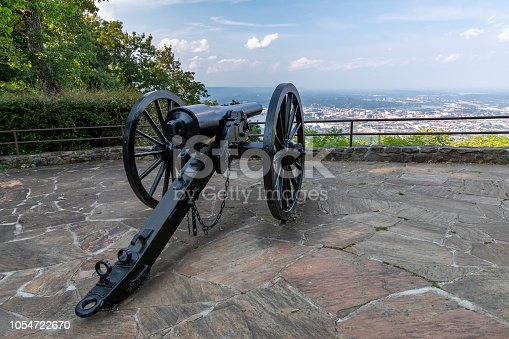 An old civil war cannon at a scenic overlook.
