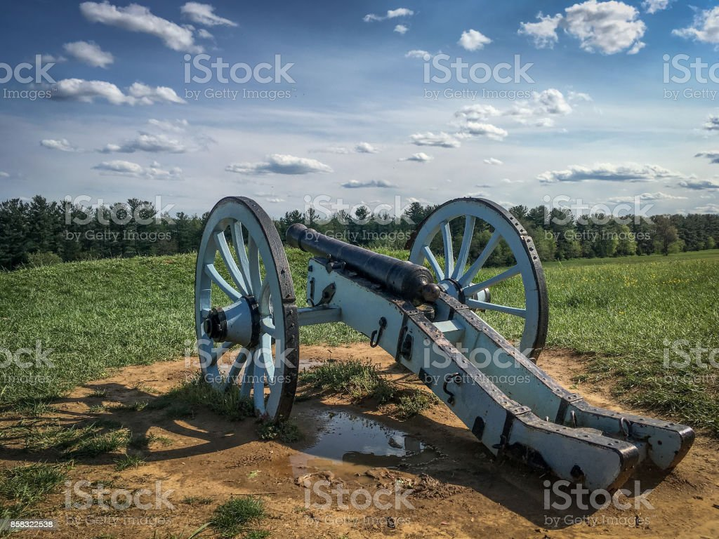 Civil War Cannon on a Battlefield stock photo