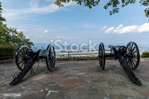 A pair of old civil war cannons at a scenic overlook.