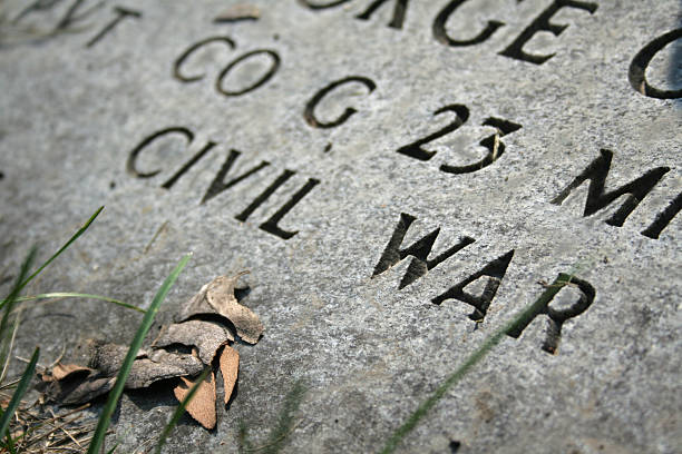 Civil War Gravestone Gravestone of a civil war veteran american civil war stock pictures, royalty-free photos & images