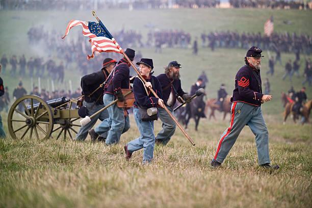 Civil War Reenactment Soldiers Running With Artillery Piece