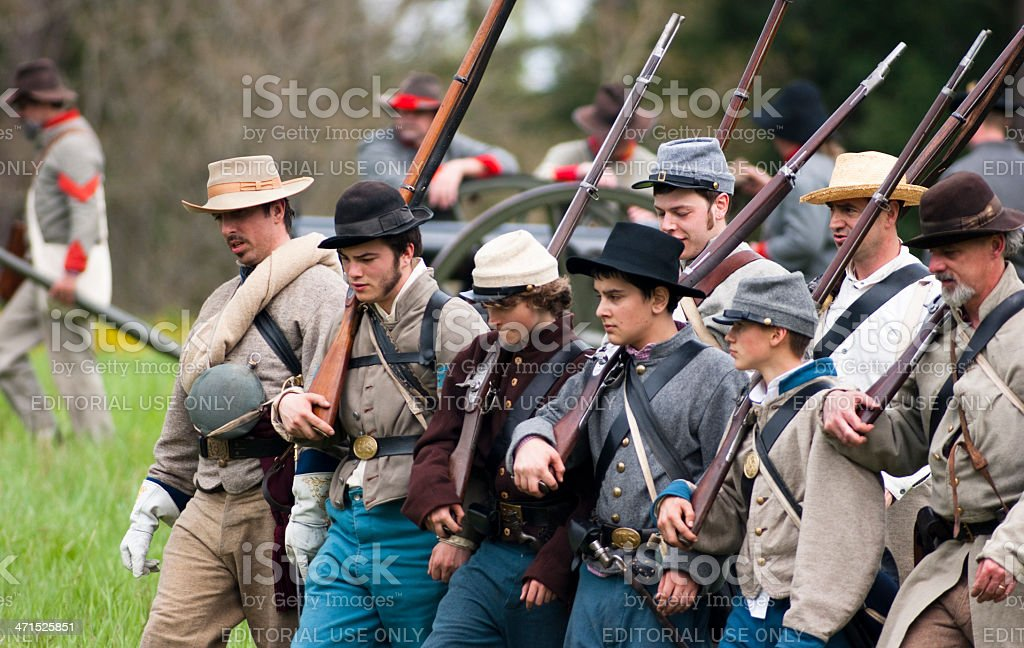 Civil War Re-enactment Union Soldiers March Holding Muskets During Battle stock photo