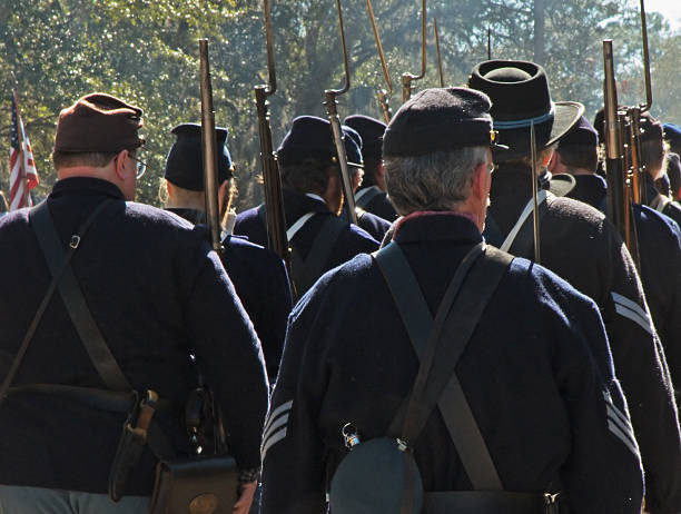 Civil War Reenactment - Union troops marching Federal (Union Army) troops depicted in a civil war reenactment. american civil war stock pictures, royalty-free photos & images