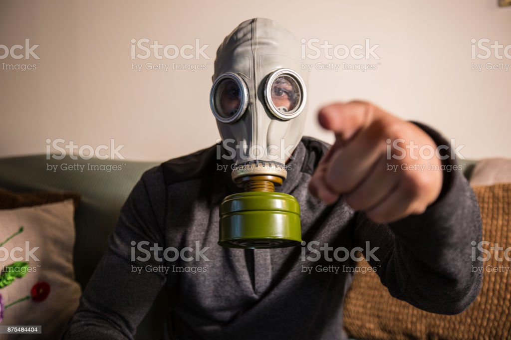 Civilian wearing nuclear gas mask during nuclear fallout stock photo