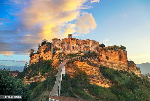 Civita di Bagnoregio ghost town landmark, aerial panoramic view on sunset. Lazio, Italy, Europe.