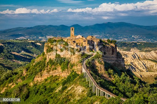 Beautiful view of famous Civita di Bagnoregio with Tiber river valley in golden evening light, Lazio, Italy.